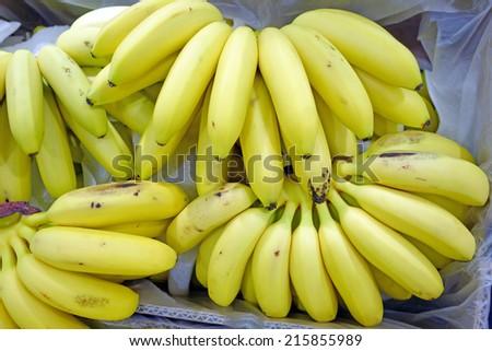 Heap ripe bananas in supermarket. Top view - stock photo