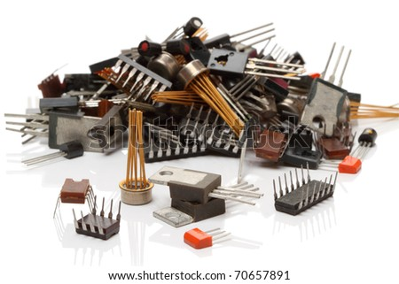 Heap various electronic components isolated on white background - stock photo