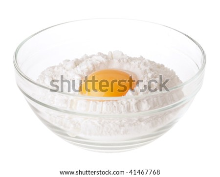 heap white meal with egg yolk in glass cup - stock photo