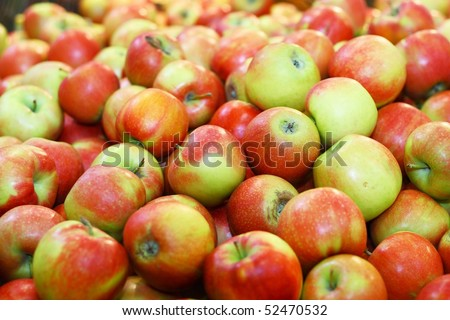 Heap with apples in big market - stock photo