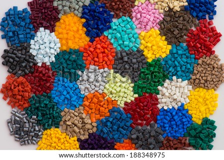 heaps of dyed plastic polymer resin - stock photo
