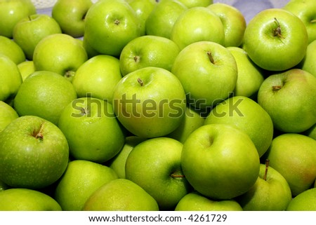 Heaps of green apples