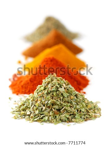Heaps of various ground spices on white background - stock photo