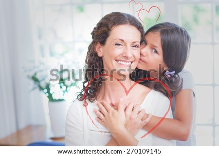 Heart against happy mother and daughter hugging - stock photo