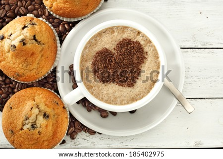 heart and coffee with muffins on desk  - stock photo