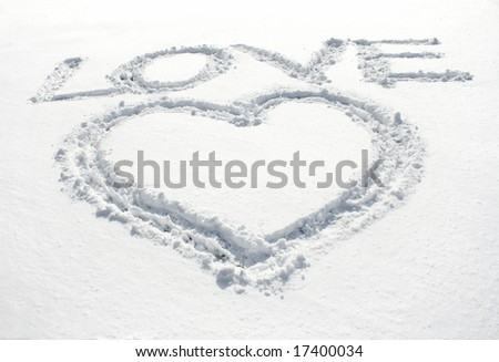 heart and inscription love written on glittering snow - stock photo