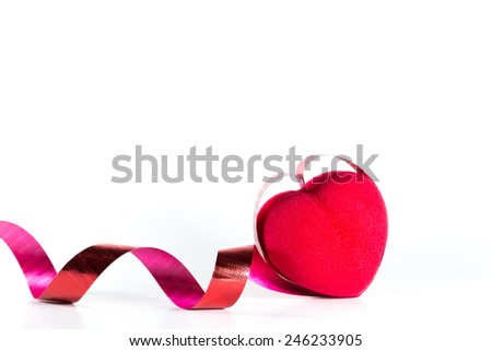 Heart and ribbon on white background