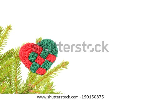 Heart and spruce branches to the left on a white background - stock photo