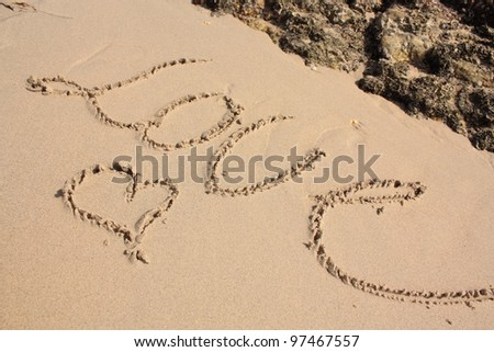Heart and word LOVE on the sandy beach