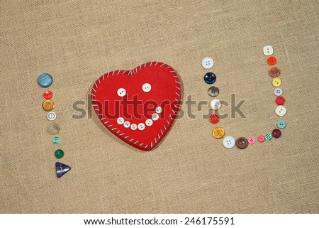 Heart and words I love U writing with different sewing buttons - stock photo