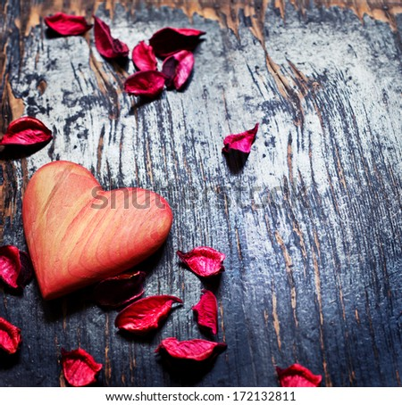 Heart as a symbol of love/vintage card with red heart on grunge old background/valentin es day background - stock photo