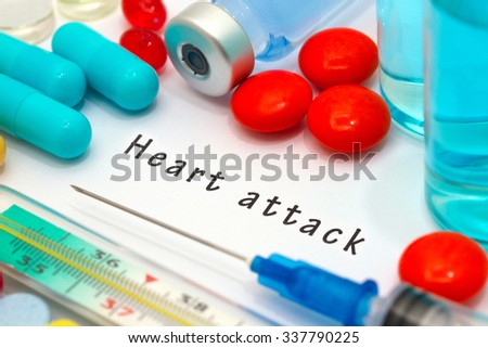 Heart attack - diagnosis written on a white piece of paper. Syringe and vaccine with drugs. - stock photo