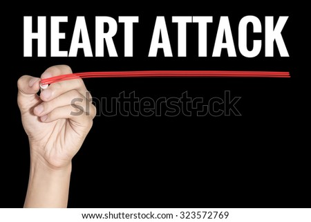 Heart Attack word writting by men hand holding highlighter pen with line on black background - stock photo
