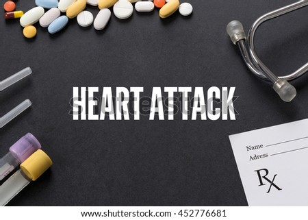 HEART ATTACK written on black background with medication