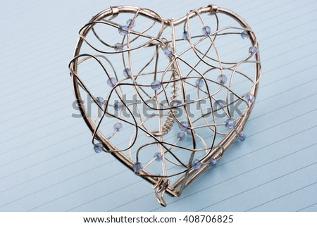 Heart cage on a lined background - stock photo