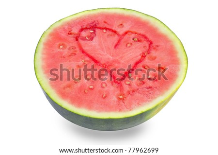 heart carved in a watermelon on a white background