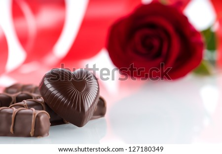 Heart, chocolates and flower - stock photo