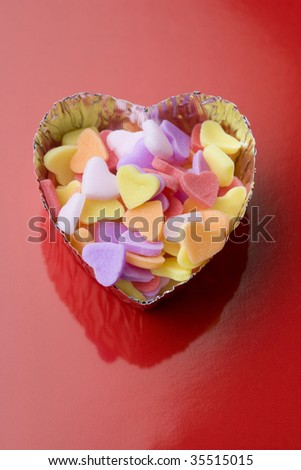 Heart chocolates isolated on red