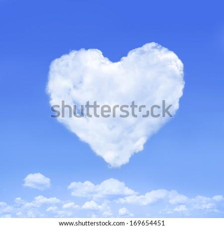 Heart cloud on blue sky. - stock photo