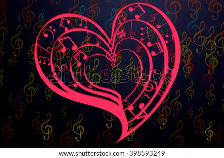 Heart collected from musical notes on dark background - stock photo