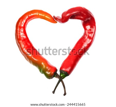 Heart composed of red chili peppers isolated on a white background