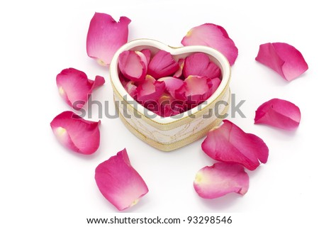 Heart cup and rose petals - stock photo