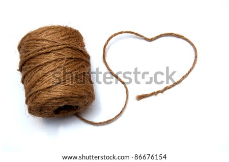Heart curved thick string and a roll isolate on white background - stock photo