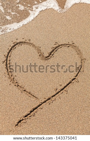 heart drawing on the beach - stock photo