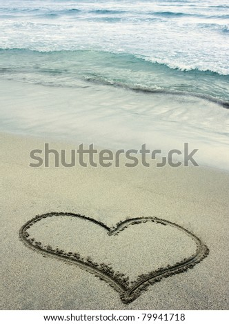 Heart drawn in sand on tropical beach
