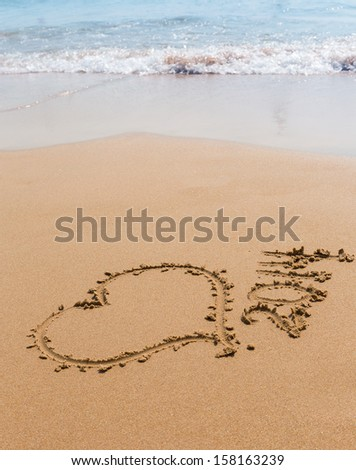 heart drawn in the sand on the beach 2014 year