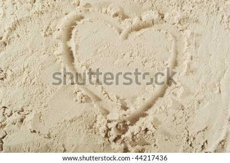 heart drawn in the smooth sand - stock photo