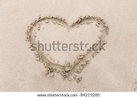 heart drawn into the sand - stock photo