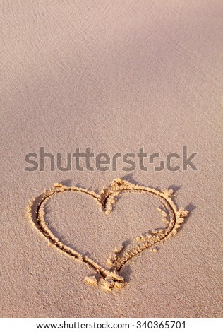 Heart drawn on sand. Heart in sand at the summer beach. - stock photo