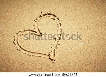 Heart drawn on sand. Horizontal composition. - stock photo