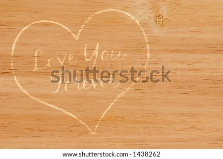 Heart engraved in wood - stock photo