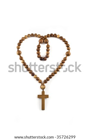 Heart figure made of Wooden beads isolated over white - stock photo