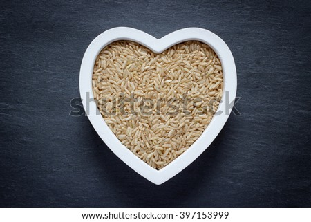 Heart filled with brown rice