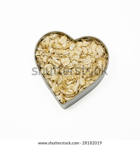 heart filled with oatmeal - stock photo