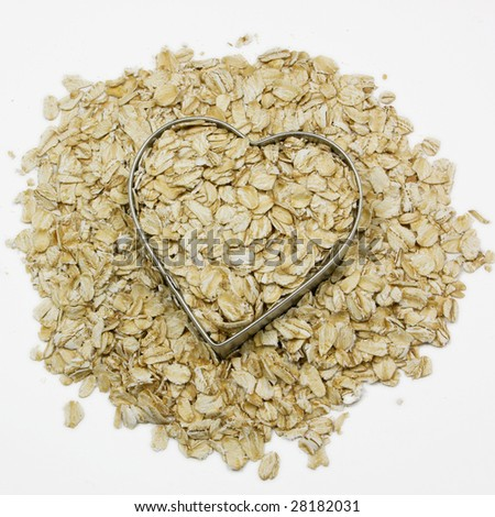 heart filled with oatmeal surrounded by oatmeal - stock photo