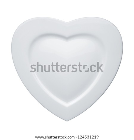 Heart form white plate isolated on white background - stock photo