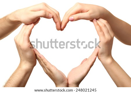 Heart formed by male and female hands isolated on white - stock photo