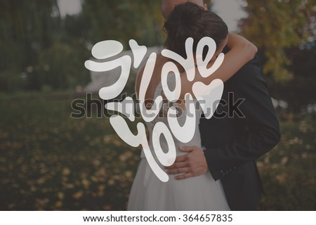 Heart Formed From happy valentine's day Text -Handmade Calligraphy. Bride and groom hugging  - stock photo