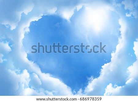 Heart frame shaped clouds on sky background.