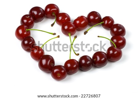 Heart from a cherry on white - stock photo