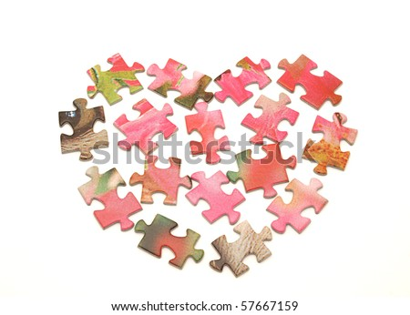 Heart from a puzzle on a white background