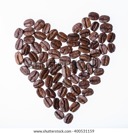 Heart from coffee beans isolated on a white background - stock photo