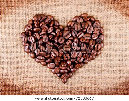 heart from coffee beans on sacking - stock photo