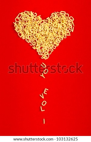 "Heart from letters and ""I love you"" on a red background - stock photo"
