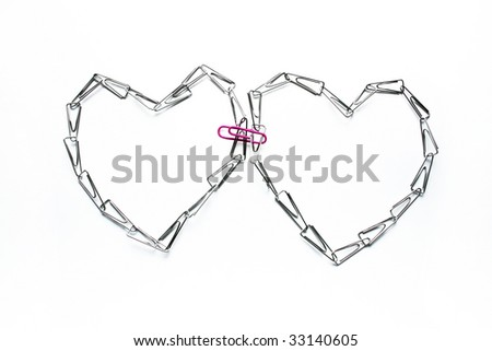 Heart from paper clips on a white background - stock photo