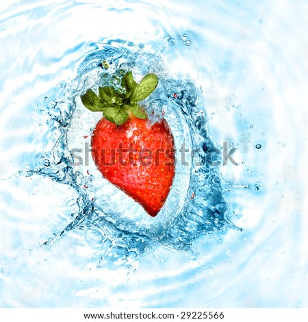 heart from strawberry dropped into water with splash isolated on white